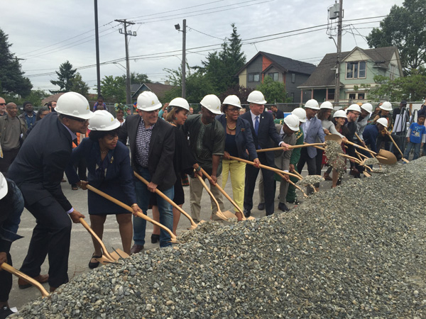 Photo by Ester Kim: The ceremonial dirt gets moved during the groundbreaking for Capitol Hill Housing